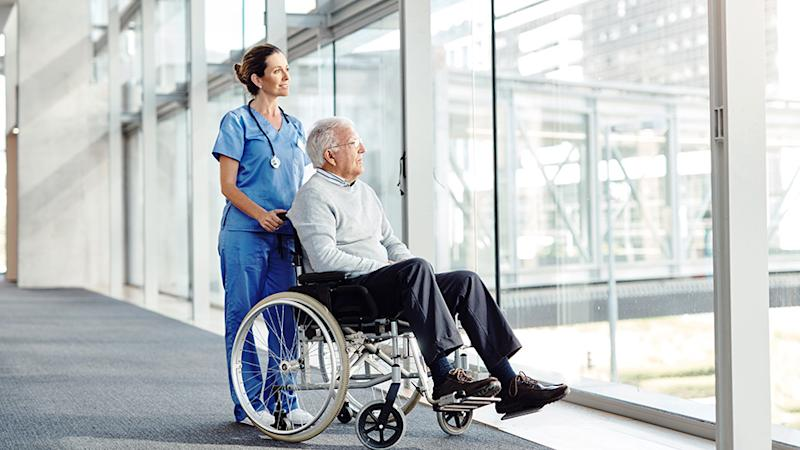 Nurse and man in wheelchair at an aged care facility