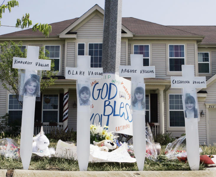 FILE - In this June 15, 2007 file photo, a makeshift memorial to Kimberly Vaughn, and her three children Abigayle, 12, Cassandra, 11, and Blake, 8, is seen outside their home in Oswego, Ill. Closing statements are scheduled to begin Thursday, Sept. 20, 2012, in Joliet, Ill., in the murder trial for Christopher Vaughn, accused of shooting dead his wife Kimberly and three kids as the family drove to a waterpark in 2007. (AP Photo/Charles Rex Arbogast, File)