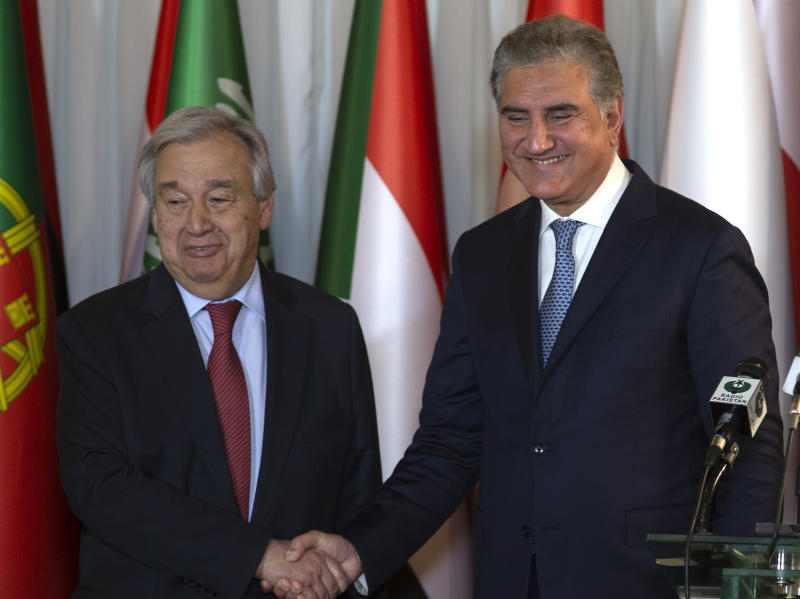 In this Sunday, Feb. 16, 2020 photo, U.N. Secretary-General Antonio Guterres, left, shakes hands with Pakistani Foreign Minister Shah Mahmood Qureshi after a joint press conference at the Foreign Ministry in Islamabad, Pakistan. After 40 years, more than 1.5 million Afghan refugees still live in neighboring Pakistan. They feel abandoned by their own government, increasingly unwelcome in their reluctant host country and ignored by the United Nations. Pakistan hosting a conference on Afghan refugees, attended by Guterres. (AP Photo/B.K. Bangash)