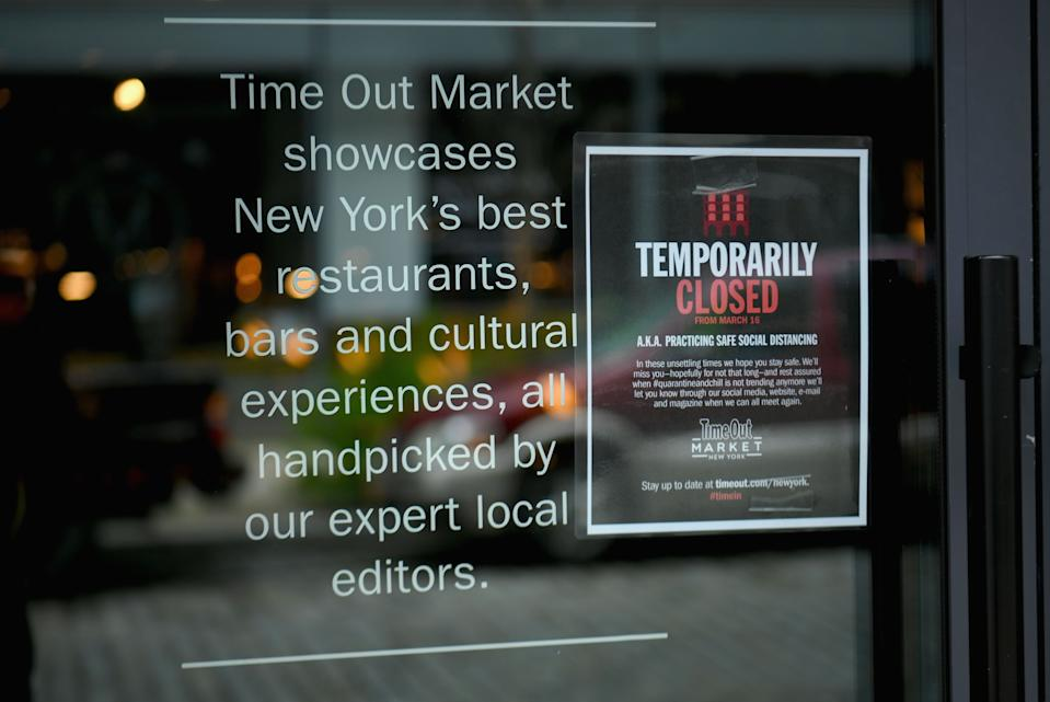 A view of the closed 'Time Out market' and food court is seen in the Dumbo neighborhood of Brooklyn, New York on March 17, 2020. - The coronavirus outbreak has transformed the US virtually overnight from a place of boundless consumerism to one suddenly constrained by nesting and social distancing.The crisis tests all retailers, leading to temporary store closures at companies like Apple and Nike, manic buying of food staples at supermarkets and big-box stores like Walmart even as many stores remain open for business -- albeit in a weirdly anemic consumer environment. (Photo by Angela Weiss / AFP) (Photo by ANGELA WEISS/AFP via Getty Images)