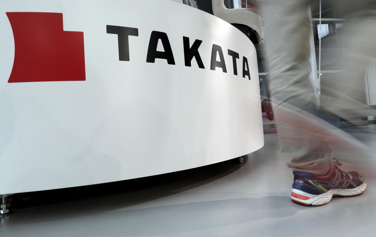 <p> In this May 10, 2017 photo, a visitor walks past the logo of Takata Corp. at a Toyota showroom in Tokyo. Japanese air bag maker Takata Corp. filed for bankruptcy protection in Tokyo on Monday, June 26, 2017 and the U.S., drowned in a sea of lawsuits and recall costs. (AP Photo/Shizuo Kambayashi) </p>