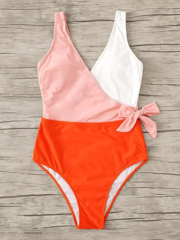 """<p><a href=""""https://www.popsugar.com/buy/Shein-Colorblock-Surplice-Neck-One-Piece-Swimsuit-584727?p_name=Shein%20Colorblock%20Surplice%20Neck%20One-Piece%20Swimsuit&retailer=us.shein.com&pid=584727&price=13&evar1=fab%3Aus&evar9=47573899&evar98=https%3A%2F%2Fwww.popsugar.com%2Fphoto-gallery%2F47573899%2Fimage%2F47573910%2FShein-Colorblock-Surplice-Neck-One-Piece-Swimsuit&list1=swimwear%2Cone-piece%20swimsuits%2Cproduct%20reviews%2Csummer%20fashion%2Cshein%2Caffordable%20shopping%2Ccheap%20obsessions&prop13=api&pdata=1"""" rel=""""nofollow"""" data-shoppable-link=""""1"""" target=""""_blank"""" class=""""ga-track"""" data-ga-category=""""Related"""" data-ga-label=""""https://us.shein.com/Colorblock-Surplice-Neck-One-Piece-Swimsuit-p-726744-cat-2193.html?scici=Search~~EditSearch~~1~~one-piece%20swimsuit%20wrap~~~~0~~0"""" data-ga-action=""""In-Line Links"""">Shein Colorblock Surplice Neck One-Piece Swimsuit</a> ($13)</p>"""