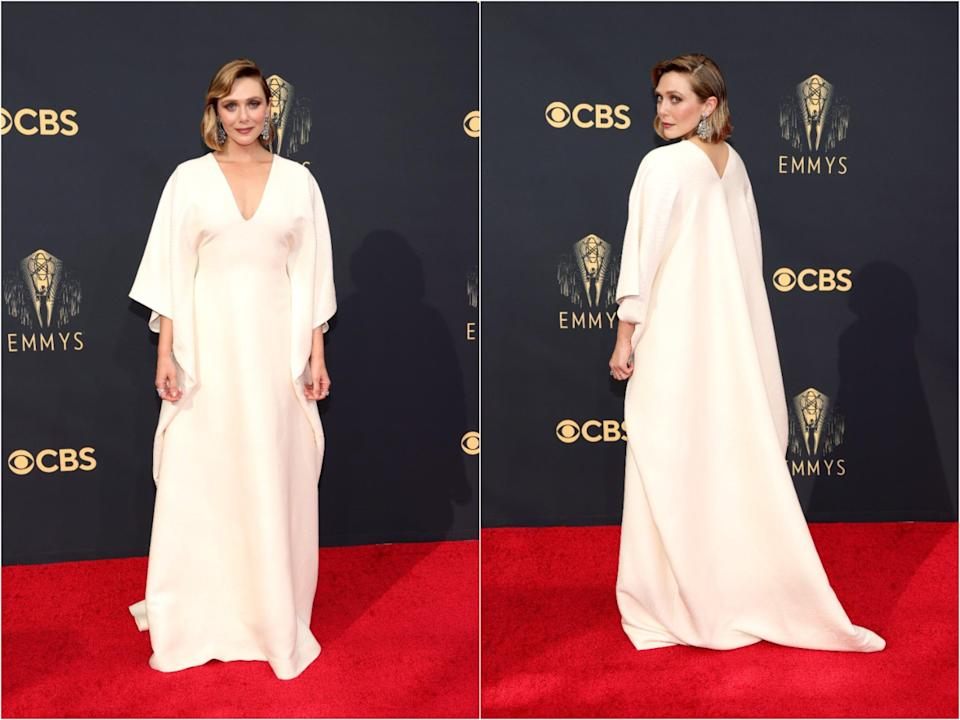 Elizabeth Olsen poses for pictures on the red carpet for the 2021 Emmy awards.