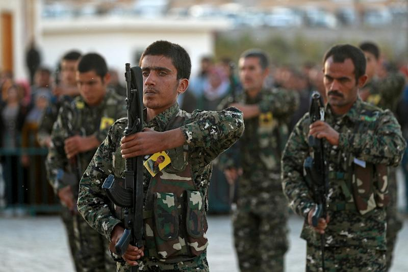 Syrian Democratic Forces fighters attend the funeral in the northern Syrian city of Kobane of a fellow fighter killed in an offensive by the Islamic State movement