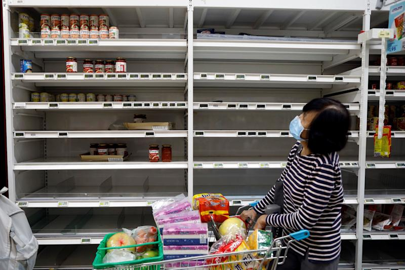 Panic buying caused the emptying of Singapore's supermarket shelves, but assurances by officials have helped ease some of the hoarding. (Photo: Edgar Su/Reuters)