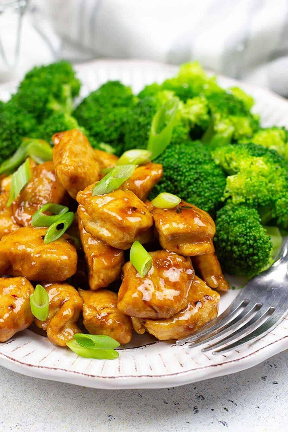 """<p>If you got 10 minutes you can make your own homemade, heart-healthy version of General Tso's Chicken faster than Grubhub could arrive at your door. It's so simple: All you need to do is mix the sauce, cook up the chicken in spices, top with green onion, and voilà! You can then sautée some of your favorite vegetables (like broccoli or string beans) to add some nutrient-dense foods to your plate.</p><p><em><a href=""""https://www.diabeticfoodie.com/general-tsos-chicken/"""" rel=""""nofollow noopener"""" target=""""_blank"""" data-ylk=""""slk:Get the recipe for Low-Carb General Tso's Chicken from Diabetic Foodie »"""" class=""""link rapid-noclick-resp"""">Get the recipe for Low-Carb General Tso's Chicken from Diabetic Foodie »</a></em></p>"""