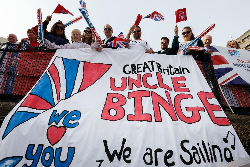 Great Britain fans cheer on the crew's during the start of the Clipper Round the World Race in London.