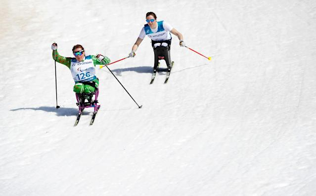 REFILE CLARIFYING CAPTION Cross-Country Skiing - Pyeongchang 2018 Winter Paralympics - Women's 1.1km Sprint - Sitting - Semi-Final - Alpensia Biathlon Centre - Pyeongchang, South Korea - March 14, 2018 - Valiantsina Shyts (126) of Belarus and Kendall Gretsch (123) of the U.S. REUTERS/Carl Recine