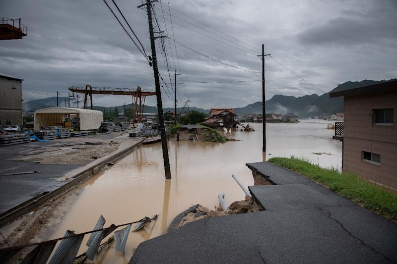 Japan rescuers search house to house as flood toll hits 141