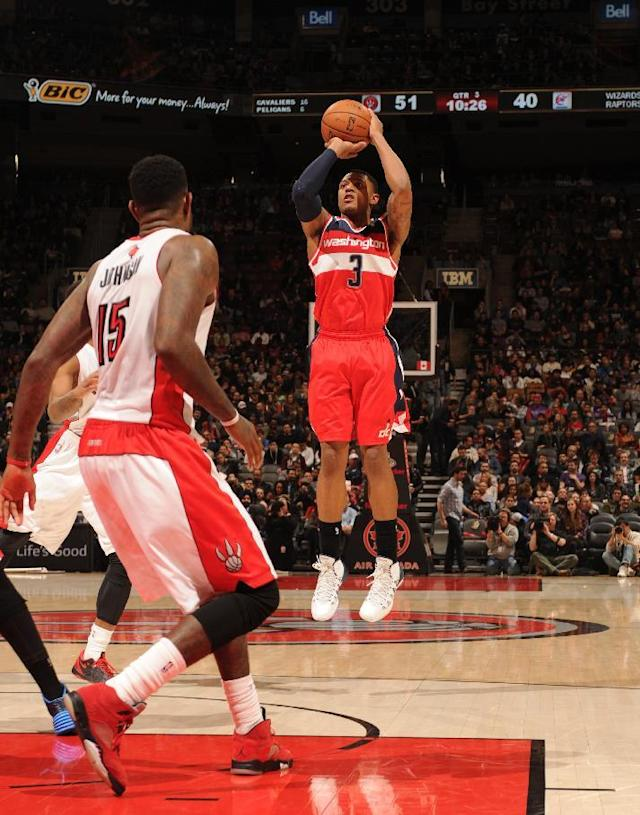TORONTO, CANADA - November 22: Bradley Beal #3 of the Washington Wizards shoots against the Toronto Raptors on November 22, 2013 at the Air Canada Centre in Toronto, Ontario, Canada. (Photo by Ron Turenne/NBAE via Getty Images)