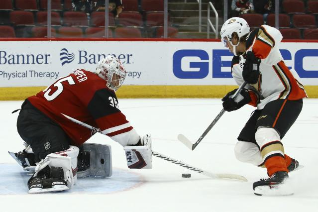 Arizona Coyotes goaltender Darcy Kuemper (35) makes a save on a shot by Anaheim Ducks left wing Rickard Rakell, right, during the shootout of a preseason NHL hockey game Saturday, Sept. 21, 2019, in Glendale, Ariz. The Coyotes won 4-3. (AP Photo/Ross D. Franklin)