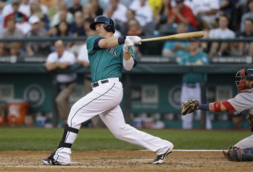Seattle Mariners' Justin Smoak hits an RBI double in the fourth inning of a baseball game against the Boston Red Sox, Monday, July 8, 2013, in Seattle. (AP Photo/Ted S. Warren)