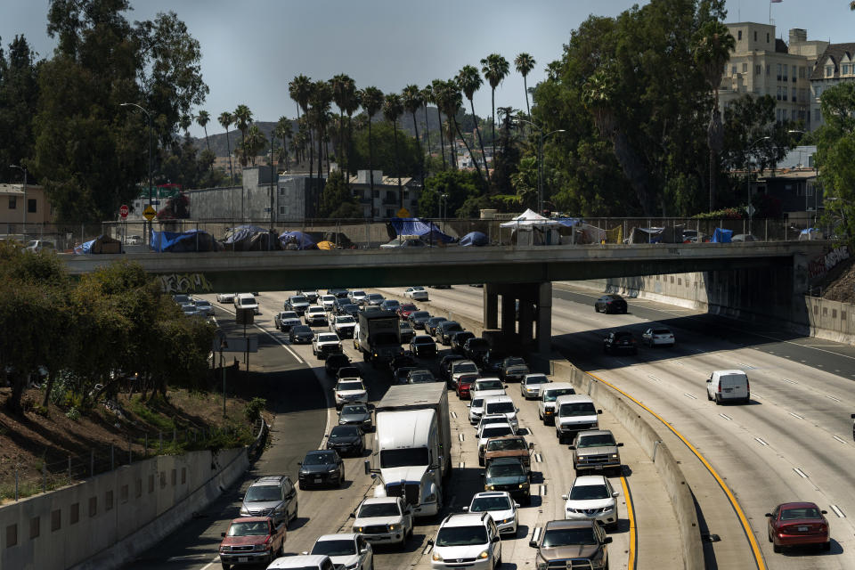 FILE - In this July 7, 2021, file photo homeless encampments are installed on an overpass of the CA-101 Hollywood freeway in Los Angeles. The share of Americans living in poverty rose slightly as the COVID pandemic shook the economy last year, but massive relief payments pumped out by Congress eased hardship for many, the Census Bureau reported Tuesday, Sept. 14. The official poverty measure showed an increase of 1 percentage point in 2020, indicating that 11.4% of Americans were living in poverty. It was the first increase in poverty after five consecutive annual declines. (AP Photo/Damian Dovarganes, File)