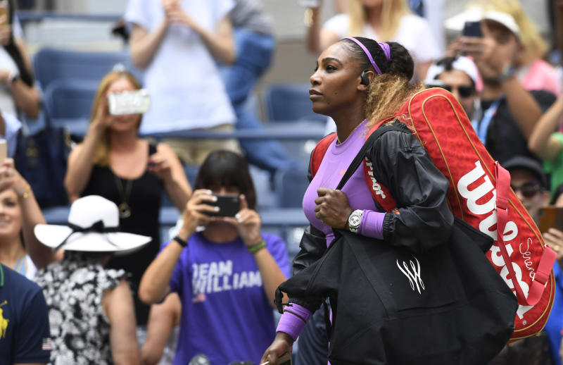 Serena Williams walks onto the court as she prepares to warm up prior to her round four match at the US Open tennis championships Sunday, Sept. 1, 2019, in New York. (AP Photo/Sarah Stier)