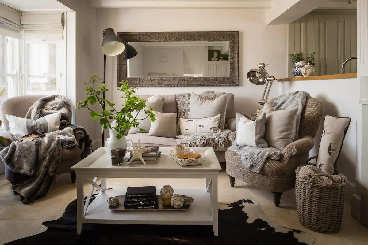 """<p>For a beach cottage that offers the seaside vibes and coastal decor straight out of an interiors magazine, this cute Airbnb in Cornwall provides all the glamour for a family staycation or break away with friends. </p><p>Its location in the heart of picturesque Mousehole is simply fabulous and you can make the most of being right on the harbour front. The interiors are luxurious, with three stylish ensuite bedrooms, rustic furniture and views of the sea from the sitting room. <strong><br></strong></p><p><strong>Sleeps</strong>: 6</p><p><strong>Price per night:</strong> £359</p><p><strong>Why we love it: </strong>The French antique-style furnishings and country-chic sofas - it's our kind of beach cottage!</p><p><a class=""""body-btn-link"""" href=""""https://go.redirectingat.com?id=127X1599956&url=https%3A%2F%2Fwww.airbnb.co.uk%2Frooms%2F36334548%3Fsource_impression_id%3Dp3_1592405679_UnI4c3N3pfGB92M7&sref=https%3A%2F%2Fwww.redonline.co.uk%2Ftravel%2Finspiration%2Fg32954008%2Fairbnb-cornwall-devon%2F"""" target=""""_blank"""">SEE INSIDE</a></p>"""