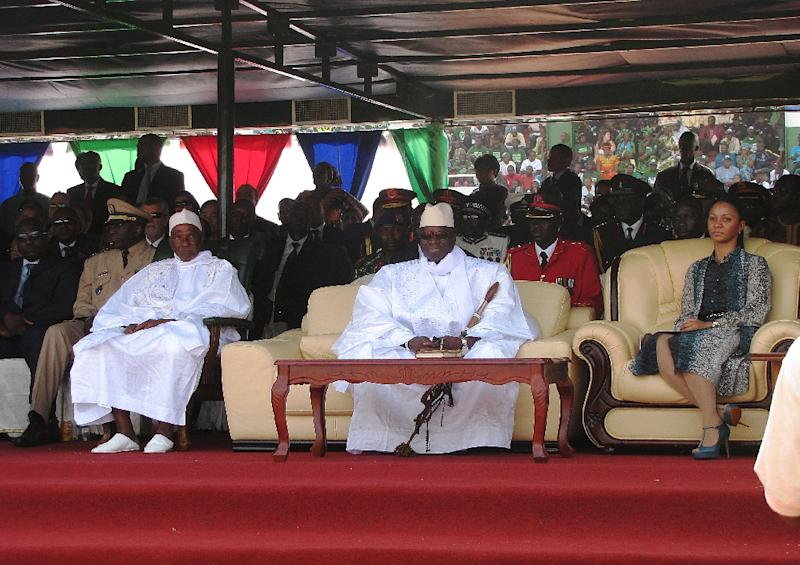 Yayah Jammeh (centre) sits with his wife Zeinab Yahya Jammeh (right) and Senegalese President Abdoulaye Wade (left) at a swearing-in ceremony for his fourth term on January 19, 2012, in Banjul (AFP Photo/Dawda Bay)