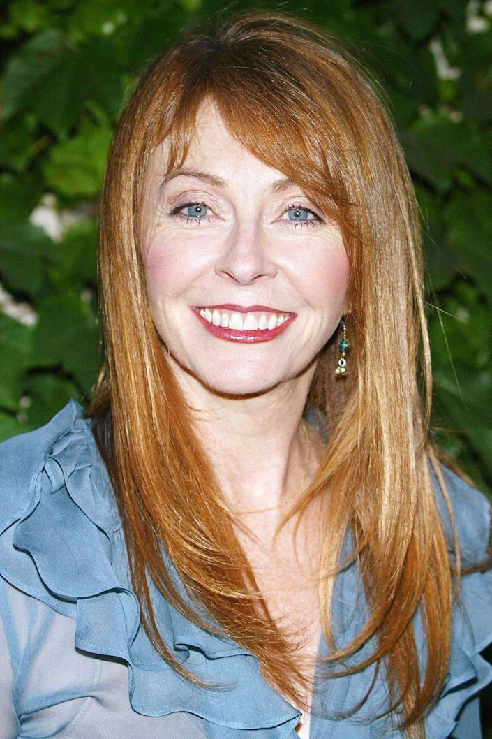 <p>It's easy to forget it's a wig hiding the pretty red hair of Cassandra Peterson!</p>