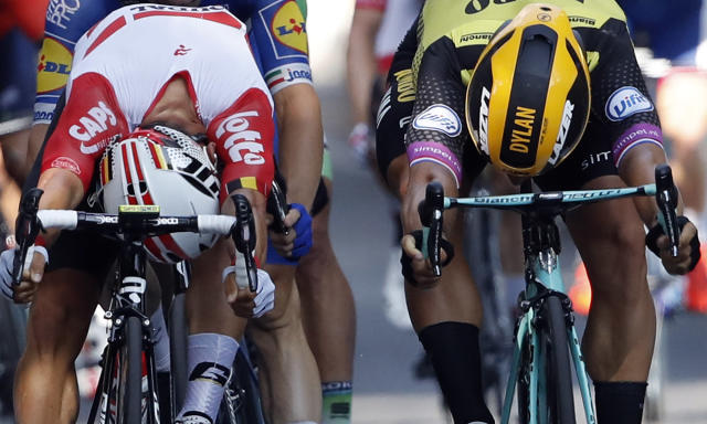 Australia's Caleb Ewan, left, and Netherlands' Dylan Groenewegen crosses the finish line during the eleventh stage of the Tour de France cycling race over 167 kilometers (103,77 miles) with start in Albi and finish in Toulouse, France, Wednesday, July 17, 2019. Ewan won the stage. (AP Photo/Christophe Ena)