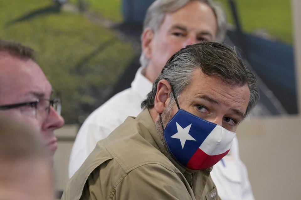 Sen. Ted Cruz, R-Texas, and Texas Gov. Greg Abbott listen during a briefing with President Donald Trump about Hurricane Laura at the emergency operations center Saturday, Aug. 29, 2020, in Orange, Texas. (AP Photo/Alex Brandon)