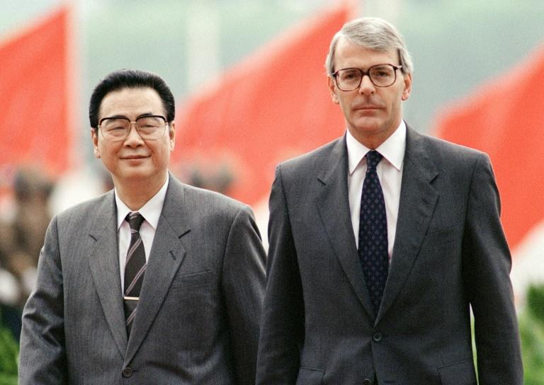 Li Peng, walking across Tiananmen Square with British prime minister John Major in 1991, later tried to minimise his role in the 1989 crackdown (AFP Photo/Mike FIALA)