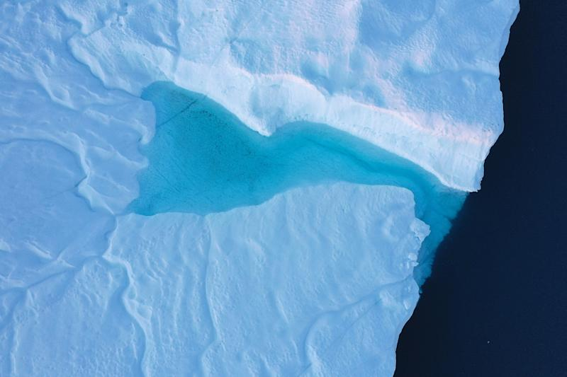 In this aerial view meltwater forms a pond on an iceberg in the Ilulissat Icefjord near Ilulissat, Greenland. (Photo: Sean Gallup/Getty Images)