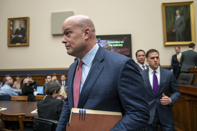 Acting Attorney General Matthew Whitaker arrives to testify before the House Judiciary Committee on Capitol Hill in Washington, Friday, Feb. 8, 2019. (AP Photo/J. Scott Applewhite)