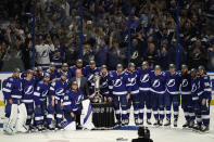 Members of the Tampa Bay Lightning pose for a photo with the Prince of Wales trophy after defeating the New York Islanders during Game 7 of an NHL hockey Stanley Cup semifinal playoff series Friday, June 25, 2021, in Tampa, Fla. (AP Photo/Chris O'Meara)