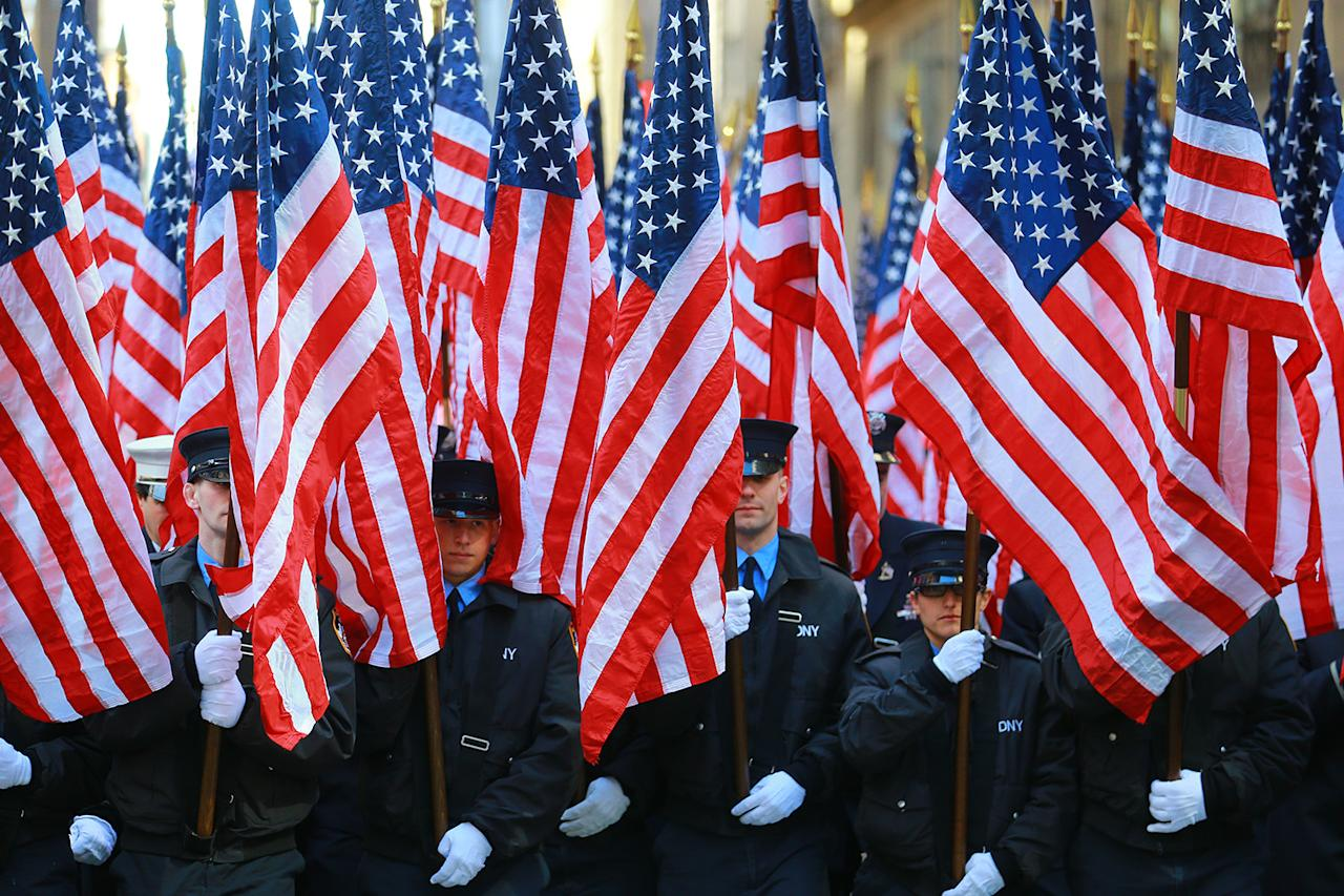 <p>Members of the Fire Department of New York Color Guard march on Fifth Avenue during the St. Patrick's Day Parade on March 17, 2018, in New York. (Photo: Gordon Donovan/Yahoo News) </p>