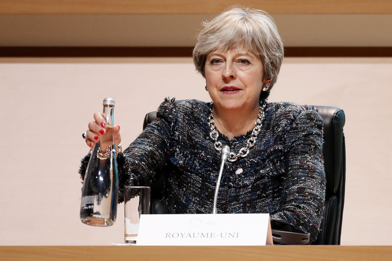<p> British Prime Minister Theresa May attends the plenary session of One Planet Summit, in Boulogne-Billancourt near Paris, France, Tuesday, Dec. 12, 2017. World leaders, investment funds and energy magnates promised to devote new money and technology to slow global warming at a summit in Paris that President Emmanuel Macron hopes will rev up the Paris climate accord that U.S. President Donald Trump has rejected. (Etienne Laurent/Pool Photo via AP) </p>