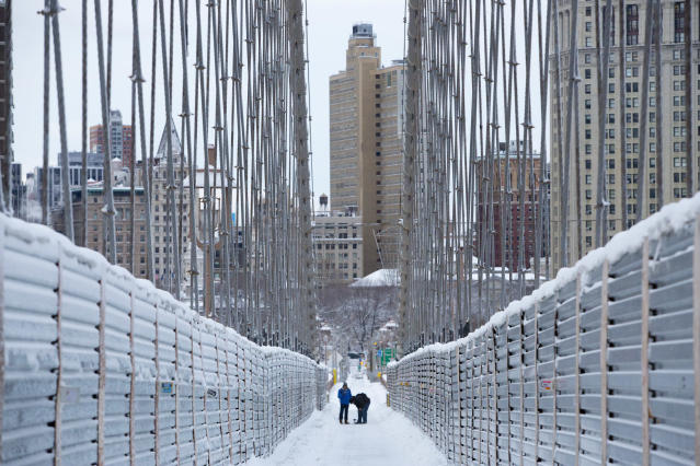 NEW YORK, NY - FEBRUARY 09: People walk along the Brooklyn Bridge following a major winter storm on February 9, 2013 in New York City. New York City and much of the Northeast received a foot or more of snow through Saturday morning with possible record-setting blizzard conditions expected. Heavy snow warnings are in effect from New Jersey through southern Maine. (Photo by Andrew Kelly/Getty Images)