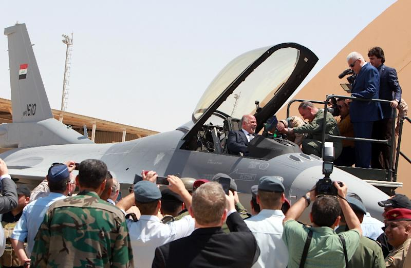 Iraqi Prime Minister Haidar al-Abadi sits in a F-16 fighter jet at Balad air base on July 20, 2015