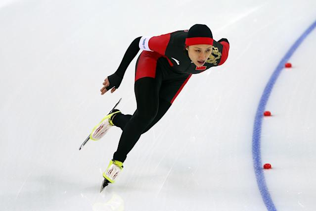 SOCHI, RUSSIA - FEBRUARY 13: Hong Zhang of China competes during the Women's 1000m Speed Skating event on day 6 of the Sochi 2014 Winter Olympics at Adler Arena Skating Center on February 13, 2014 in Sochi, Russia. (Photo by Clive Mason/Getty Images)