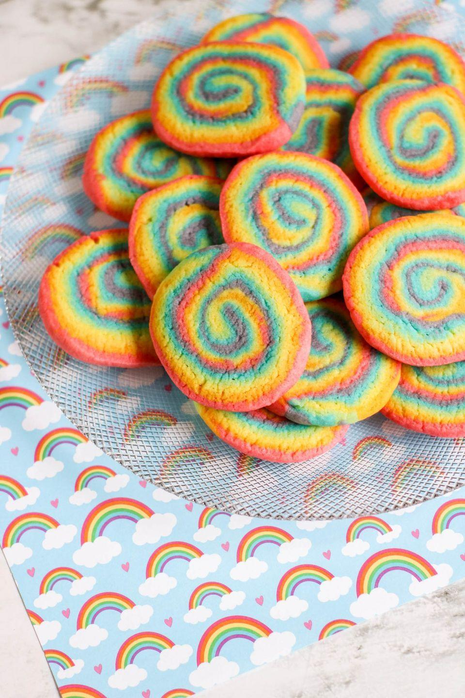 """<p>These slice-and-bake sugar cookies are easy to make. Layer the colors, roll the dough into a log, cut your cookies, then bake.</p><p><strong>Get the recipe at <a href=""""https://www.aboutamom.com/rainbow-swirl-cookies/"""" rel=""""nofollow noopener"""" target=""""_blank"""" data-ylk=""""slk:About a Mom"""" class=""""link rapid-noclick-resp"""">About a Mom</a>.</strong></p><p><strong><a class=""""link rapid-noclick-resp"""" href=""""https://go.redirectingat.com?id=74968X1596630&url=https%3A%2F%2Fwww.walmart.com%2Fsearch%2F%3Fquery%3Dcookie%2Btray&sref=https%3A%2F%2Fwww.thepioneerwoman.com%2Ffood-cooking%2Fmeals-menus%2Fg36421919%2Frainbow-recipes%2F"""" rel=""""nofollow noopener"""" target=""""_blank"""" data-ylk=""""slk:SHOP COOKIE SHEETS"""">SHOP COOKIE SHEETS</a><br></strong></p>"""
