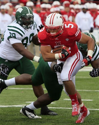 Miami (Ohio) running back Jamire Westbrook (5) runs past Ohio defenders Carl Jones, left, and Antwan Crutcher for a one-yard touchdown in the first half of an NCAA college football game, Saturday, Oct. 27, 2012, in Oxford, Ohio. (AP Photo/Al Behrman)