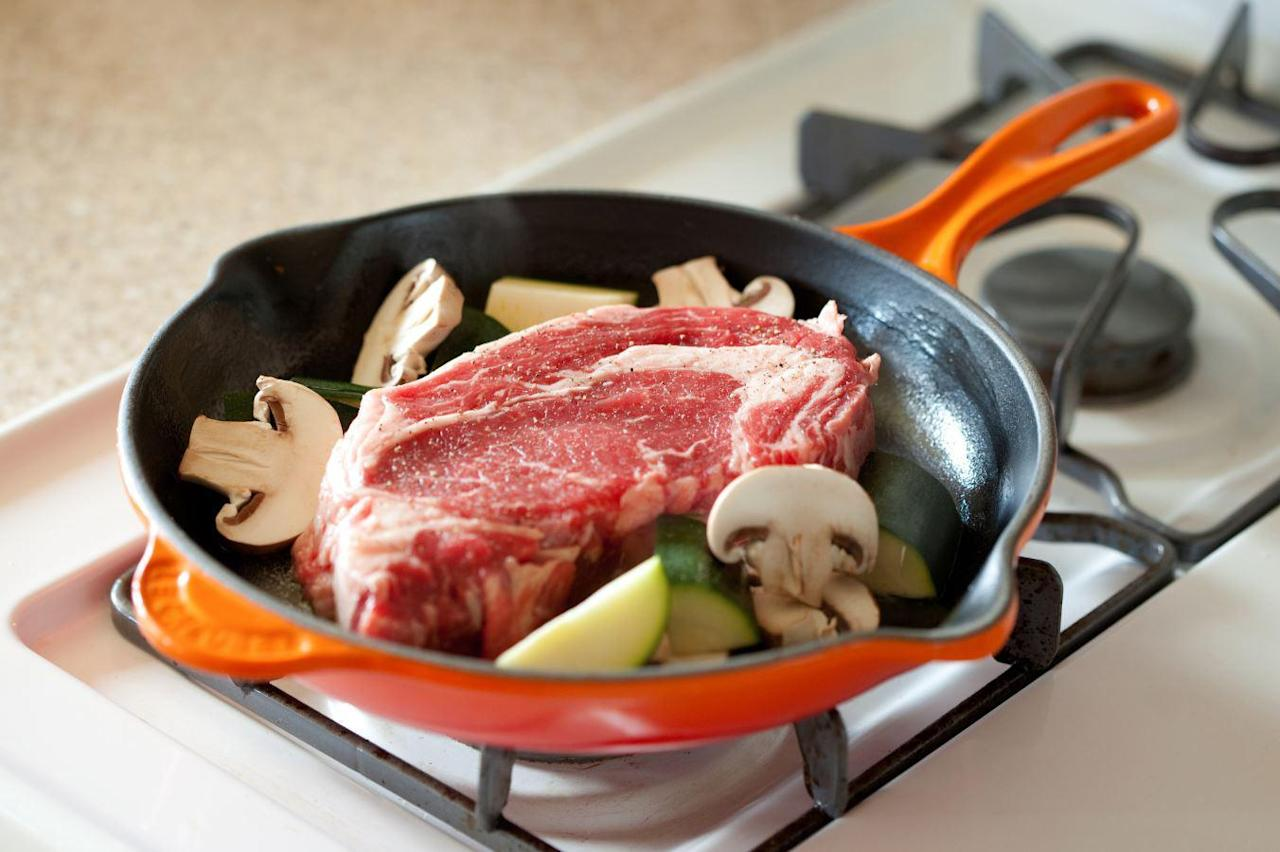 """<p>A cast iron pan is essential for <a href=""""https://www.thedailymeal.com/cook/how-cook-perfect-steak-gallery?referrer=yahoo&category=beauty_food&include_utm=1&utm_medium=referral&utm_source=yahoo&utm_campaign=feed"""">making steak on the stove perfectly every time</a>. Just make sure that the steak (or any food) you put into your pan isn't ice cold. If it is, it might stick.</p>"""