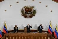 Venezuela's new president of the assembly, Jorge Rodriguez (C), first vice president Iris Varela (L) and second vice president Didalco Bolivar
