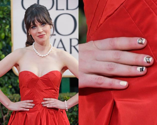 "Zooey Deschanel's red carpet signature has become her nail art and at the 2013 Golden Globes her film reel manicure was another ""adorkable"" look."