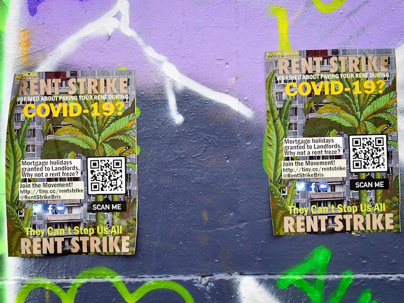 Posters referencing Covid-19 and a rent strike: Ben Birchall/PA Wire/PA Images