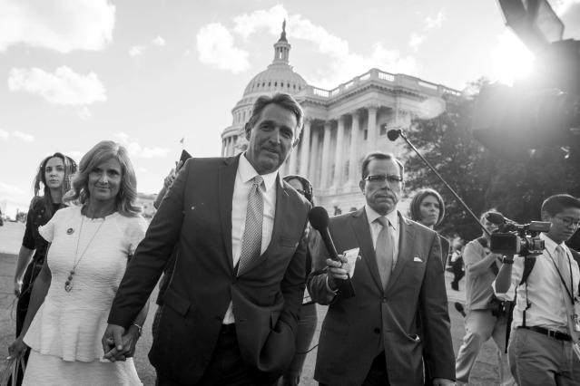 Sen. Jeff Flake, R-Ariz., accompanied by his wife, Cheryl, leaves the Capitol in Washington on Oct. 24, 2017, after announcing he won't seek reelection in 2018. (Photo: Andrew Harnik/AP)