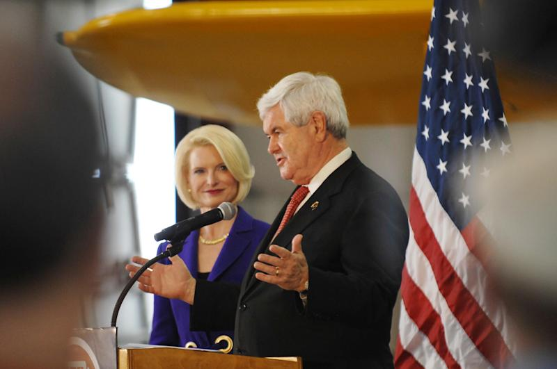 Republican presidential candidate Newt Gingrich and his wife Callista great supporters at the Lake in the Hills Airport, Thursday, March 15, 2012 in Lake in the Hills, Ill. (AP Photo/Daily Herald, John Starks) MANDATORY CREDIT; MAGS OUT; TV OUT