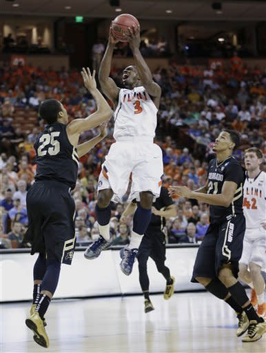 Illinois' Brandon Paul (3) shoots over Colorado's Spencer Dinwiddie (25) during the first half of a second-round game of the NCAA college basketball tournament Friday, March 22, 2013, in Austin, Texas. (AP Photo/Eric Gay)