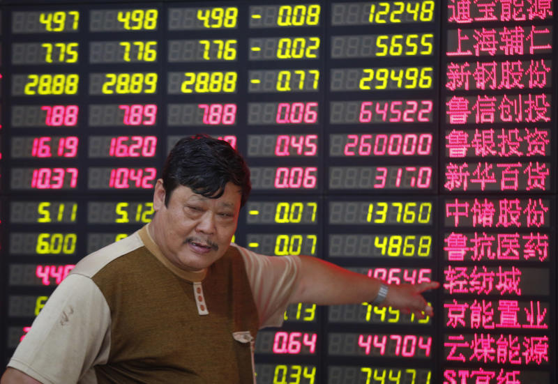 An investor points at the stock price monitor at a private securities company in Shanghai, China Friday July 26, 2013. Asian stock markets floundered Friday as China pressed ahead with industrial restructuring that is contributing to slowing growth in the world's No. 2 economy. (AP Photo)