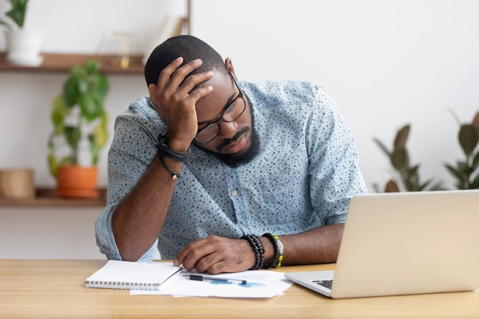 One in seven (14%) men say they have been unable to sleep due to money worries. (Getty Images)