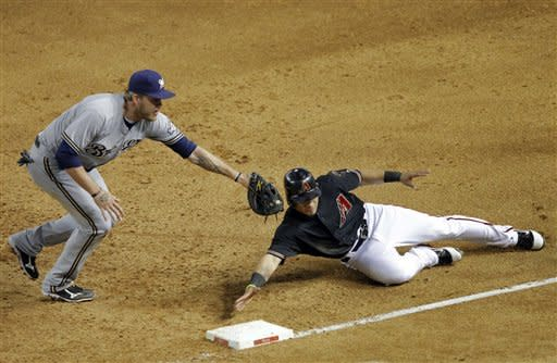 Milwaukee Brewers' Corey Hart, left, tags out Arizona Diamondbacks' Gerardo Parra, who was caught off base during the second inning of a baseball game, Saturday, May 26, 2012, in Phoenix. (AP Photo/Matt York)