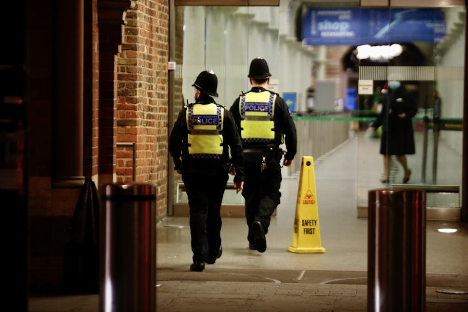 LONDON, UNITED KONGDOM - DECEMBER 20: Police officers patrol at St Pancras International train station in London, United Kingdom on December 20, 2020. several European countries ban travel to and from the UK due to fears over the emergence of a new variant of coronavirus. Large parts of south-east England, including London, are now under a new, stricter level of restrictions to curb the spread of the virus during the upcoming holiday season. (Photo by Hasan Esen/Anadolu Agency via Getty Images)