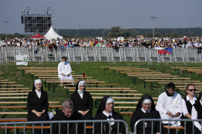 People attend a Mass celebrated by Pope Francis in the esplanade of the National Shrine in Sastin, Slovakia, Wednesday, Sept. 15, 2021. Pope Francis celebrated an open air Mass in Sastin, the site of an annual pilgrimage each September 15 to venerate Slovakia's patron, Our Lady of Sorrows (AP Photo/Petr David Josek)