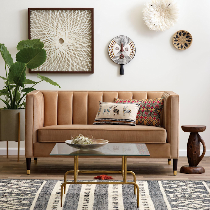 "<h3><strong>World Market</strong> </h3><br><br><strong>Best For: Globally-Inspired Furniture & Decor<br></strong>An absolute mecca for affordable global-inspired home goods — if you're hunting for a unique piece minus the premium price-tag, World Market's stock has it covered from <a href=""https://www.worldmarket.com/product/round-white-marble-milan-coffee-table.do"" rel=""nofollow noopener"" target=""_blank"" data-ylk=""slk:gilded coffee tables"" class=""link rapid-noclick-resp"">gilded coffee tables</a> to <a href=""https://www.worldmarket.com/product/wood-and-gold-triangle-wall-shelf.do"" rel=""nofollow noopener"" target=""_blank"" data-ylk=""slk:sculpturesque storage solutions"" class=""link rapid-noclick-resp"">sculpturesque storage solutions</a> and <a href=""https://www.worldmarket.com/product/half+round+mirror+with+acacia+wood+shelf.do"" rel=""nofollow noopener"" target=""_blank"" data-ylk=""slk:eclectic decor"" class=""link rapid-noclick-resp"">eclectic decor</a> (that's more often than not on sale).<br><br><strong><em><a href=""https://www.worldmarket.com/"" rel=""nofollow noopener"" target=""_blank"" data-ylk=""slk:Shop World Market"" class=""link rapid-noclick-resp"">Shop World Market</a></em></strong><br><br><strong>Cost Plus World Market</strong> Camel Leanna Tufted Loveseat, $, available at <a href=""https://go.skimresources.com/?id=30283X879131&url=https%3A%2F%2Fwww.worldmarket.com%2Fproduct%2Fcamel-leanna-tufted-loveseat.do"" rel=""nofollow noopener"" target=""_blank"" data-ylk=""slk:Cost Plus World Market"" class=""link rapid-noclick-resp"">Cost Plus World Market</a>"