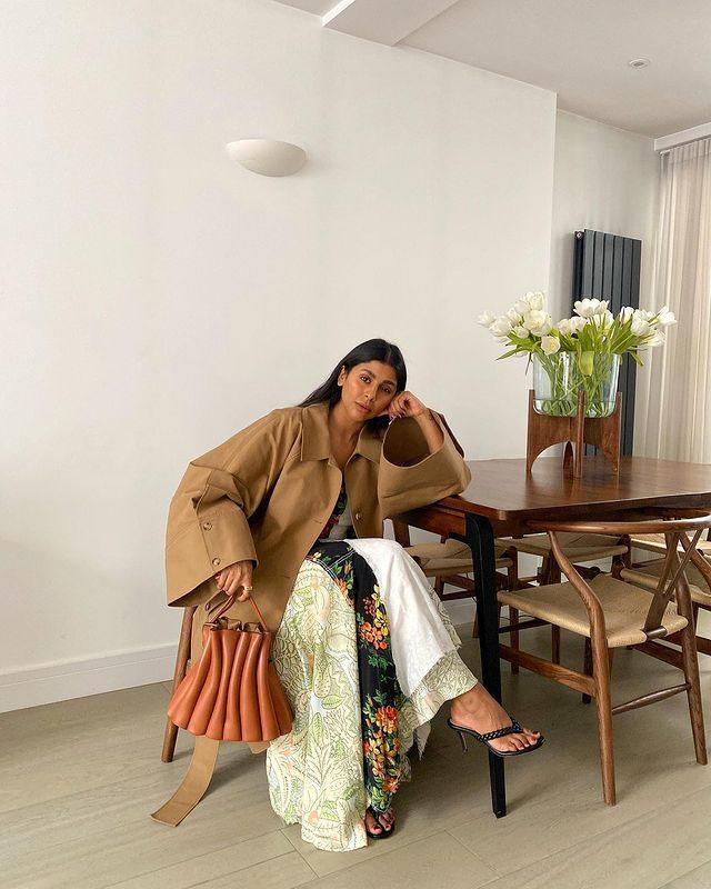 """<p>This combination of <a href=""""https://www.elle.com/uk/fashion/what-to-wear/articles/g30975/best-trench-coats-beige-navy-black/"""" rel=""""nofollow noopener"""" target=""""_blank"""" data-ylk=""""slk:trench coat"""" class=""""link rapid-noclick-resp"""">trench coat</a>, floral dress and slip flip kitten heels from Monikh Dale screams 'spring'. </p><p><a class=""""link rapid-noclick-resp"""" href=""""https://go.redirectingat.com?id=127X1599956&url=https%3A%2F%2Fwww.cosstores.com%2Fen_gbp%2Fwomen%2Fwomenswear%2Fcoats-and-jackets%2Fcoats%2Fproduct.oversized-trench-coat-beige.0891555003.html&sref=https%3A%2F%2Fwww.elle.com%2Fuk%2Ffashion%2Fg36129428%2Fspring-outfits%2F"""" rel=""""nofollow noopener"""" target=""""_blank"""" data-ylk=""""slk:SHOP TRENCH COAT NOW"""">SHOP TRENCH COAT NOW</a></p><p><a href=""""https://www.instagram.com/p/CLzRpWWBGEW/"""" rel=""""nofollow noopener"""" target=""""_blank"""" data-ylk=""""slk:See the original post on Instagram"""" class=""""link rapid-noclick-resp"""">See the original post on Instagram</a></p>"""