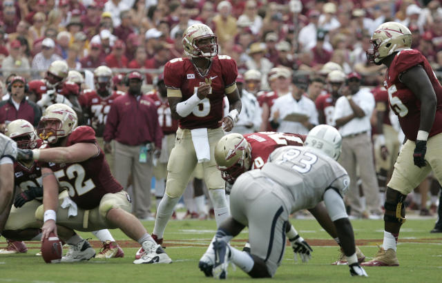 FILE - In this Saturday, Sept. 14, 2013, file photo, Florida State's Jameis Winston, center, calls signals as he checks the defense of Nevada during an NCAA college football game in Tallahassee, Fla. The Seminoles scored five offensive touchdowns during an 8:15 span in the 62-7 rout against Nevada. That was impressive, but coach Jimbo Fisher believes the unit can move faster. (AP Photo/Steve Cannon, File)