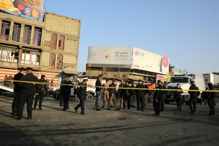Iraqi security forces cordon off the area where a double suicide bombing killed 31 people in central Baghdad on January 15, 2018, the second such attack in the Iraqi capital in three days